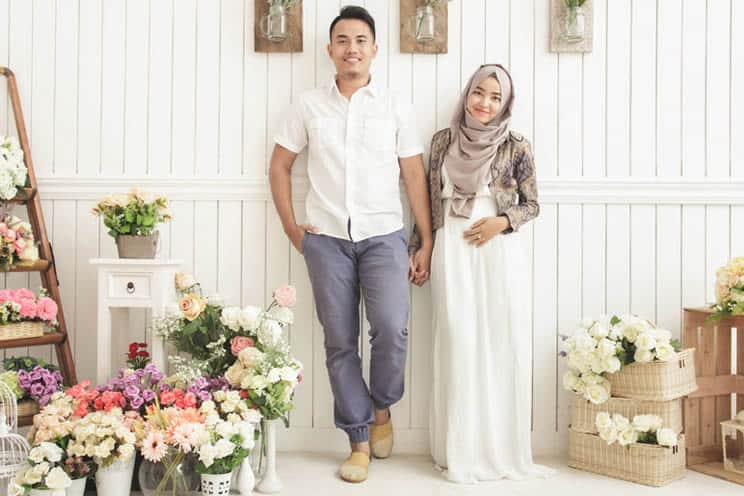 Married muslim couple surrounded by flowers