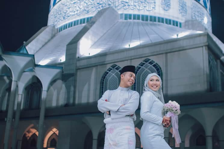Muslim bride and groom outside mosque